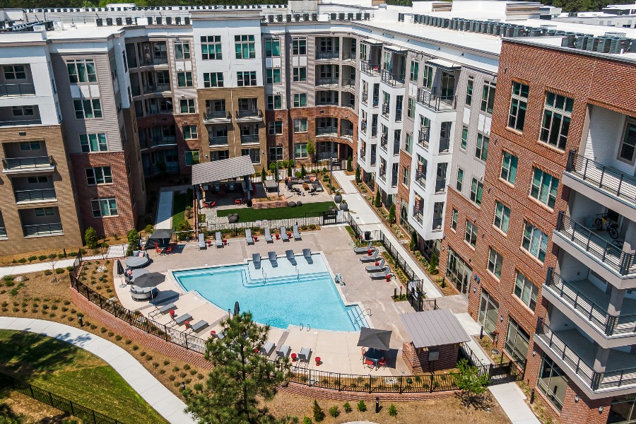 Exterior of community with pool
